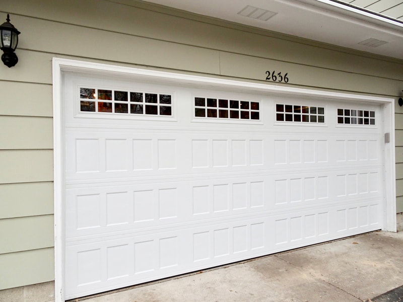 Amarr Designer's Choice in White with Recessed Panels, Insulated Glass, and Stockton Windows.  Installed by Augusta Garage Door in St. Cloud, MN.