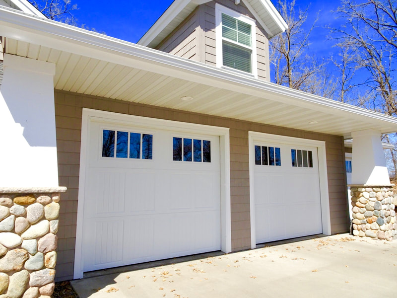 Amarr Classica in White with Tuscany Panels and Thames Windows (Insulated Glass).  Installed by Augusta Garage Door in St. Augusta, MN.