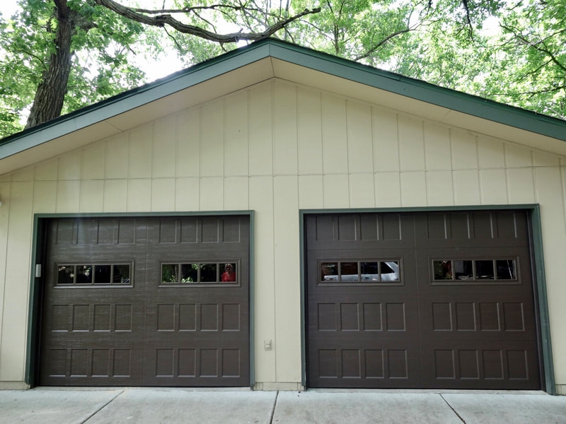 Amarr Hillcrest 3000 in Dark Brown with Recessed Panels and Thames Windows.  Installed by Augusta Garage Door in Kimball, MN.