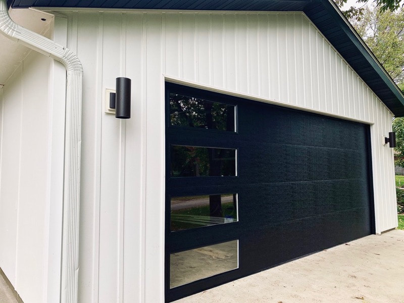 Wayne Dalton Garage Door Model 8300 in Black with Contemporary Panels and Vertical Clear Lites.  Installed by Augusta Garage Door in Avon, MN.