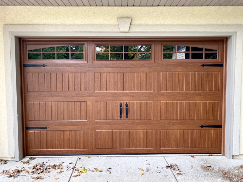 Wayne Dalton Garage Door Model 8300 in Golden Oak, Sonoma Ranch Panels, Arched Stockton Windows, and Castle Rock Magnetic Hardware.  Installed by Augusta Garage Door in St. Augusta, MN.