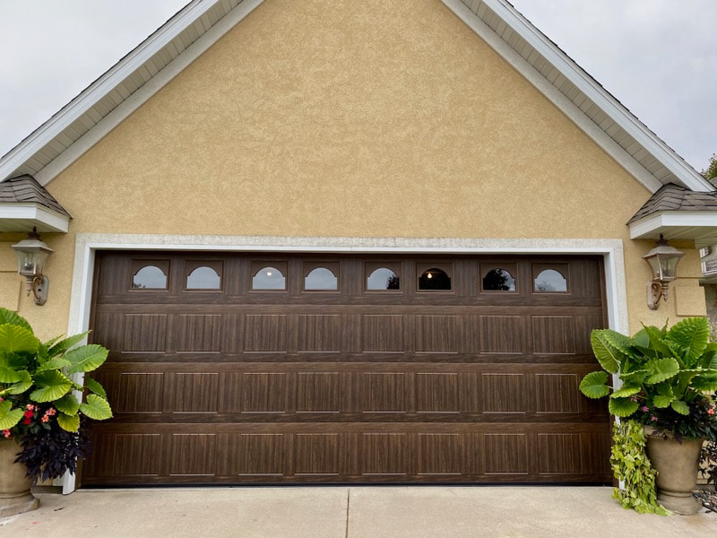 Wayne Dalton Garage Door Model 8500 in Mission Oak with Sonoma Panels and Cathedral Windows.  Installed by Augusta Garage Door in St. Cloud, MN.