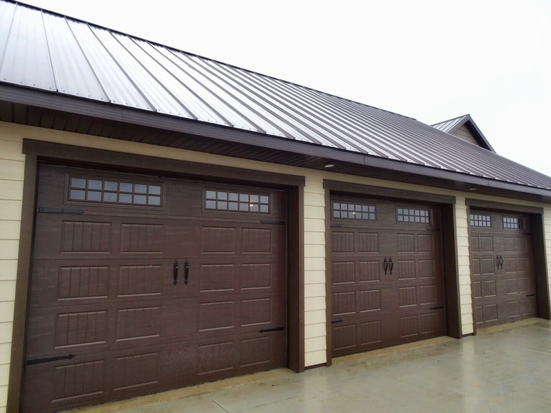 Amarr Designer's Choice Garage Door in Brown with Short Bead Board Panels and Stockton Windows.  Installed by Augusta Garage Door in Cokato, MN.