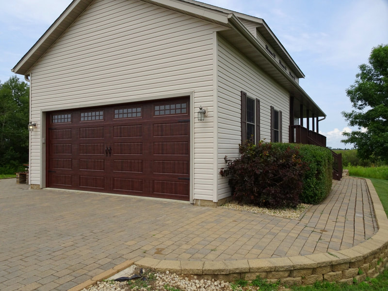 Amarr Designer's Choice Garage Door in Mahogany with LP BB Panels and Stockton Windows.  Installed by Augusta Garage Door in Foley, MN.