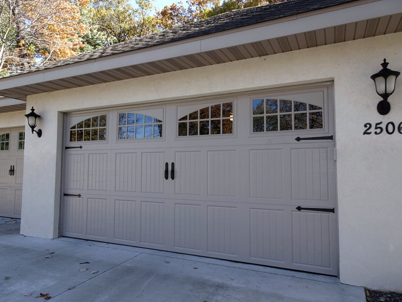 Amarr Classica Garage Door in Sandtone with Tuscany Panels and Seine Windows.  Installed by Augusta Garage Door in St. Cloud, MN.