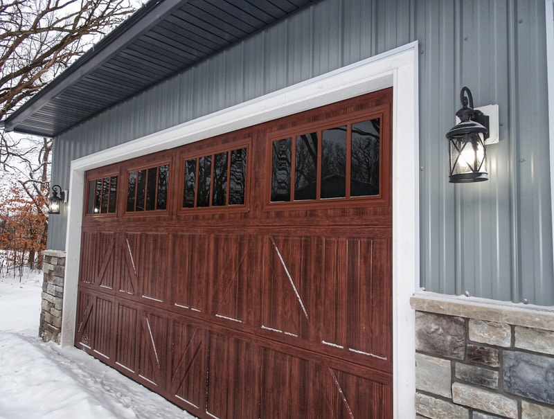 Amarr Classica Garage Door in Walnut with Lucern Panels and Thames Windows.  Installed by Augusta Garage Door in Clearwater, MN.