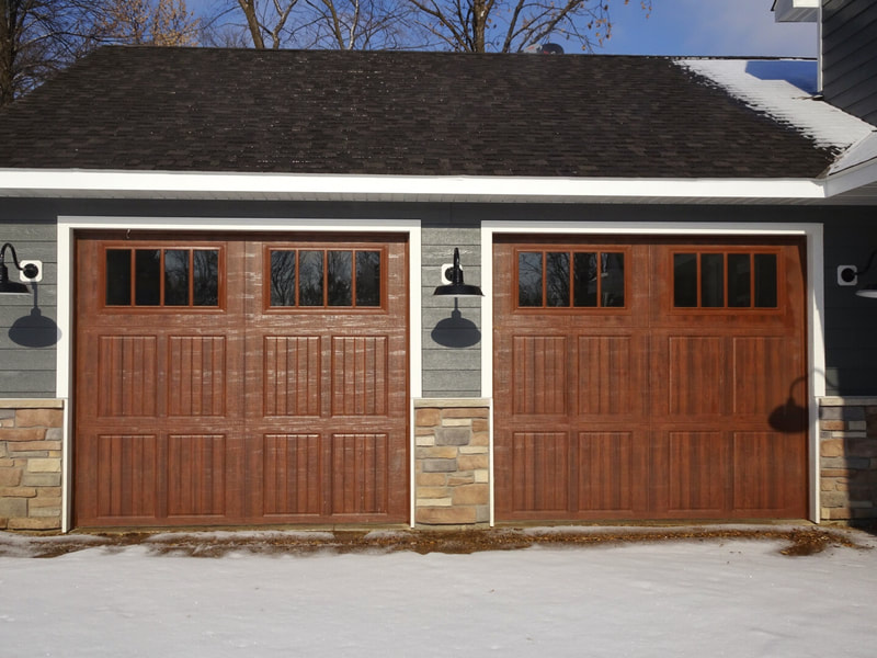 Amarr Classica Garage Door in Walnut with Cortona Panels and Thames Windows.  Installed by Augusta Garage Door in Annandale, MN.