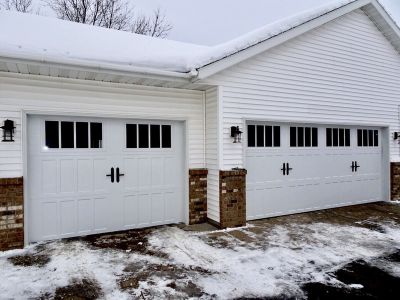 Amarr Classica Garage Doors in White with Northampton Panels and Thames Windows.  Installed by Augusta Garage Door in St. Cloud, MN.