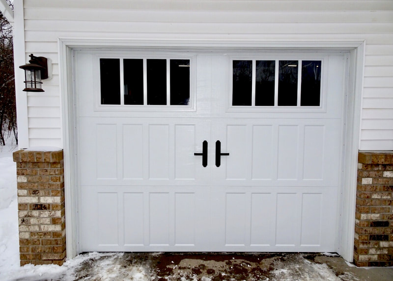 Amarr Classica Garage Door in White with Northampton Panels and Thames Windows.  Installed by Augusta Garage Door in St. Cloud, MN.