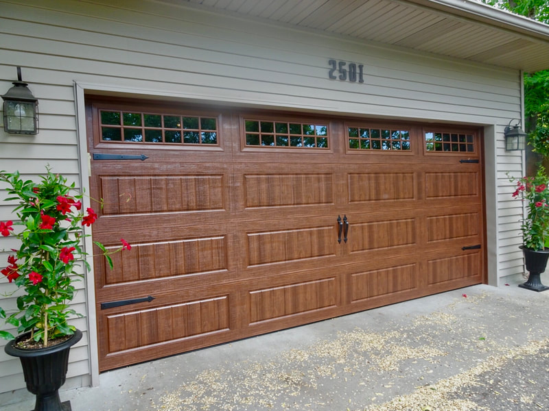 Amarr Hillcrest 3000 Garage Door in Walnut with Long Panel Bead Board Panels and Stockton Windows.  Installed by Augusta Garage Door in St. Cloud, MN.