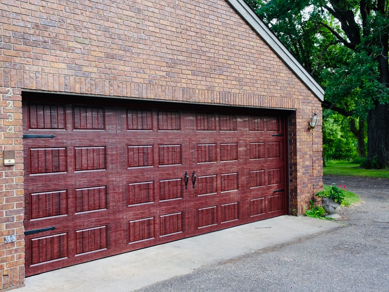 Amarr Hillcrest 3000 Garage Door in Mahogany with Short Panel Bead Board and Decorative Hardware.  Installed by Augusta Garage Door in St. Cloud, MN.