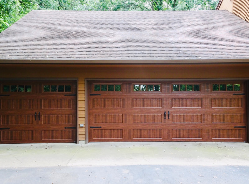 Amarr Hillcrest 3000 Garage Door in Walnut with Long Panel Bead Board and Thames Windows.  Installed by Augusta Garage Door in St. Cloud, MN.