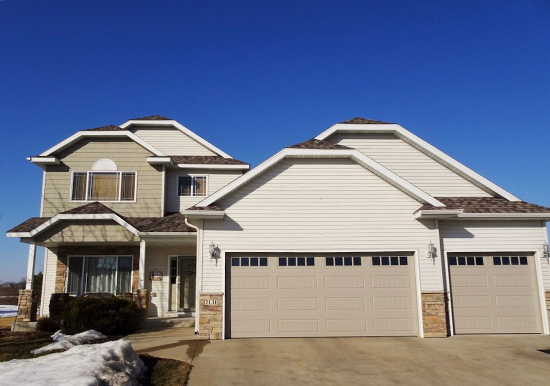Amarr Hillcrest 3000 Garage Doors in Sandtone in Long Panel Bead Board and Thames Windows.  Installed by Augusta Garage Door in Sartell, MN.