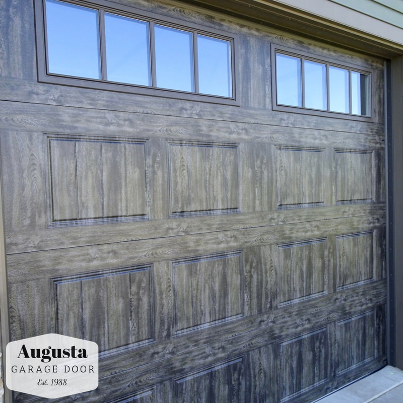 Clopay Gallery Series in Oak Slate with REC14 Windows.  Installed by Augusta Garage Door in Cold Spring, MN.