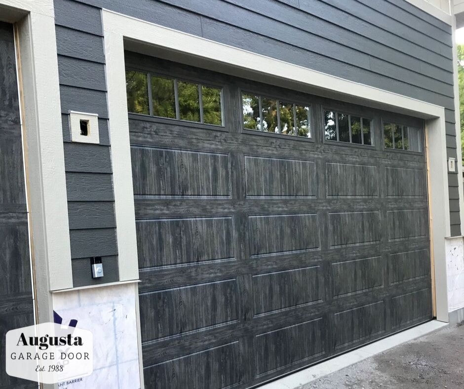 Clopay Gallery Collection in Ultra-Grain Slate with REC14 Windows.  Installed by Augusta Garage Door in South Haven, MN.