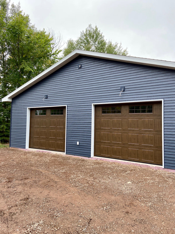 Wayne Dalton Model 8500 in Mission Oak, Sonoma Panel, Stockton III Insulated Glass.  Installed by Augusta Garage Door in St. Cloud, MN.