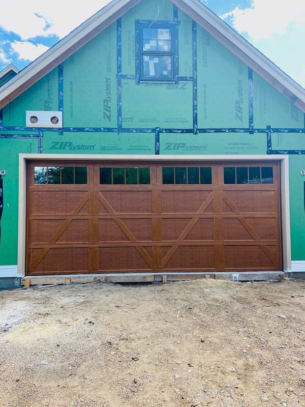 Wayne Dalton Model 9700 in Natural Oak with Charleston Panels and Stockbridge Insulated Glass.  Installed by Augusta Garage Door in Annandale, MN.
