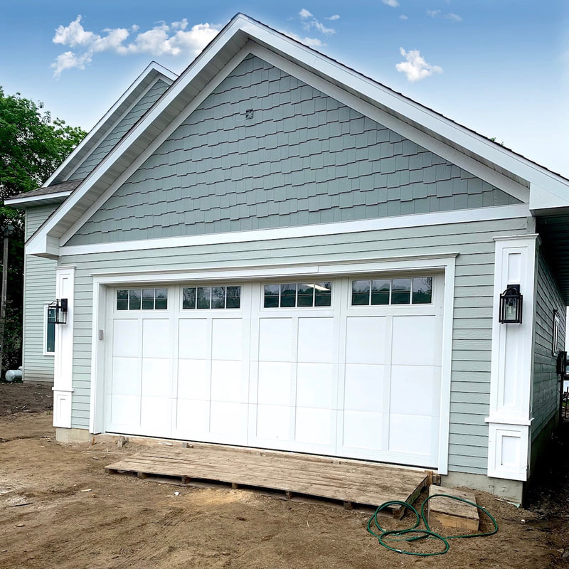 Wayne Dalton Model 6600  in White with Somerset Panels and Stockbridge Insulated Glass.  Installed by Augusta Garage Door in Annandale, MN.