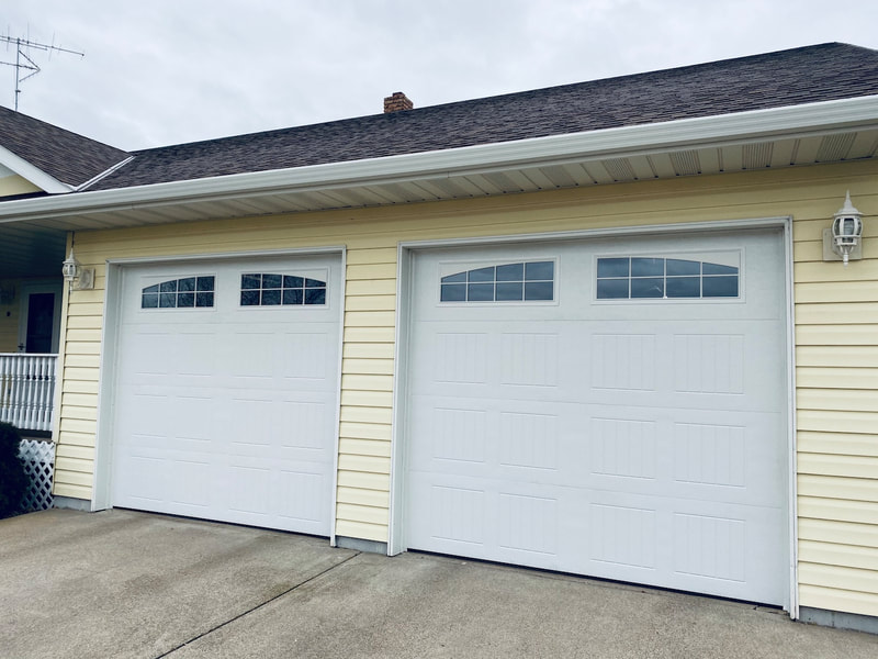 Wayne Dalton Model 8300 in White with Sonoma Panels and Arched Stockton Windows.  Installed by Augusta Garage Door in Avon, MN.