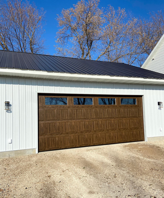 Wayne Dalton Model 8500 in Mission Oak, Sonoma Panel, Clear Insulated Windows.  Installed by Augusta Garage Door in Foley, MN.