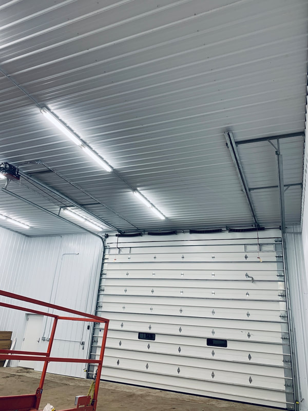 Wayne Dalton Thermospan 200 with LiftMaster Dual Trolly Operator.  Installed by Augusta Garage Door in Clear Lake, MN.